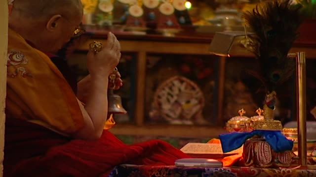 zo from the dalai lama ringing a bell or drilbu while meditating in the tsuglagkhang temple hh the 14th dalai lama tenzin gyatso lives in exile in... - meditating stock videos & royalty-free footage