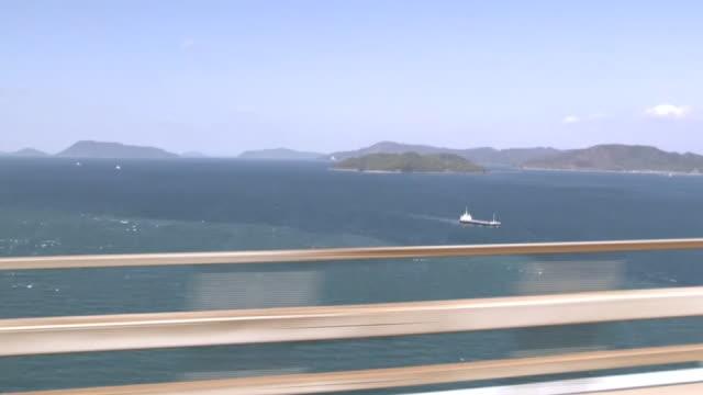 pov from the great seto bridge, kagawa, japan - 最大点の映像素材/bロール