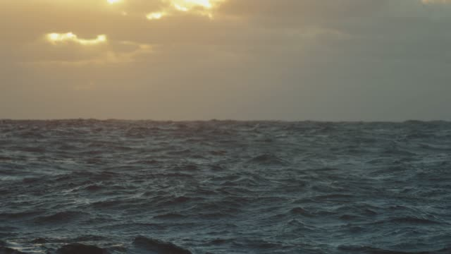 from the porthole window of a vessel: calm sunset sea - north sea stock videos & royalty-free footage