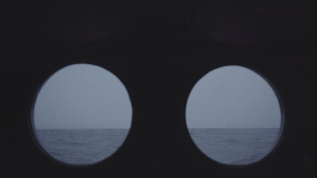 from the porthole window of a vessel in a calm sea - passenger ship stock videos & royalty-free footage