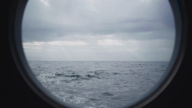 from the porthole window of a vessel in a rough sea - ferry stock videos & royalty-free footage
