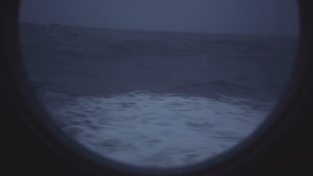 from the porthole window of a vessel in a rough sea - side view stock videos & royalty-free footage
