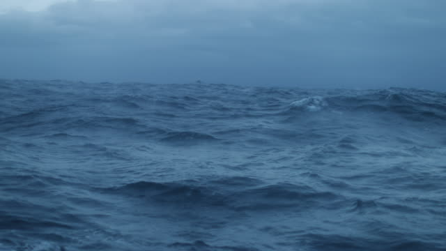 From the porthole window of a vessel in a rough sea