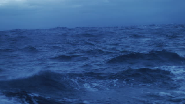 from the porthole window of a vessel in a rough sea - wave stock videos & royalty-free footage
