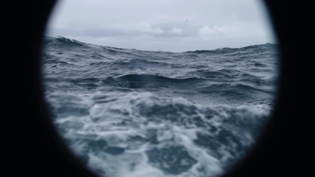 from the porthole window of a vessel in a rough sea - small boat stock videos & royalty-free footage