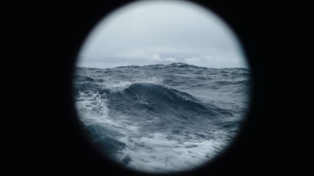 from the porthole window of a vessel in a rough sea - rough stock videos and b-roll footage