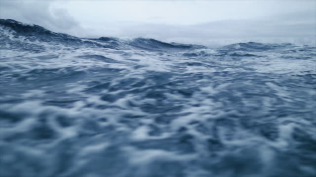 from the porthole window of a vessel in a stormy sea - tide stock videos & royalty-free footage