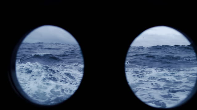from the porthole window of a vessel in a stormy sea - porthole stock videos & royalty-free footage