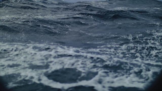 from the porthole window of a vessel in a stormy sea - side view stock videos & royalty-free footage