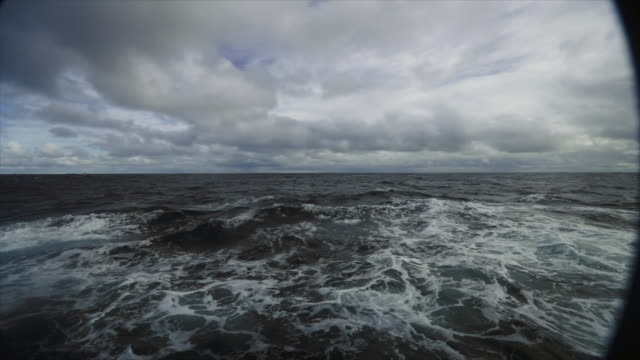from the porthole window of a vessel in rough sea - rough stock videos and b-roll footage
