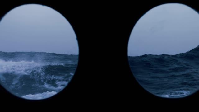 vídeos y material grabado en eventos de stock de desde la ventana del ojo de buey de un recipiente en el mar áspero - embarcación de pasajeros