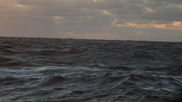 from the porthole window of a vessel in rough sea - rough stock videos & royalty-free footage