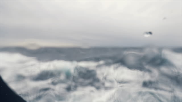 from the porthole window of a vessel in rough sea - porthole stock videos & royalty-free footage