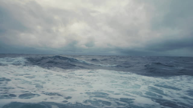 from the porthole window of a vessel in rough sea - boat stock videos & royalty-free footage