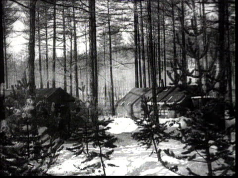 stockvideo's en b-roll-footage met from the propaganda documentary film about the construction of the bam railway 1937 hard labour camp / gulag in siberia huts in forest in winter... - 1937