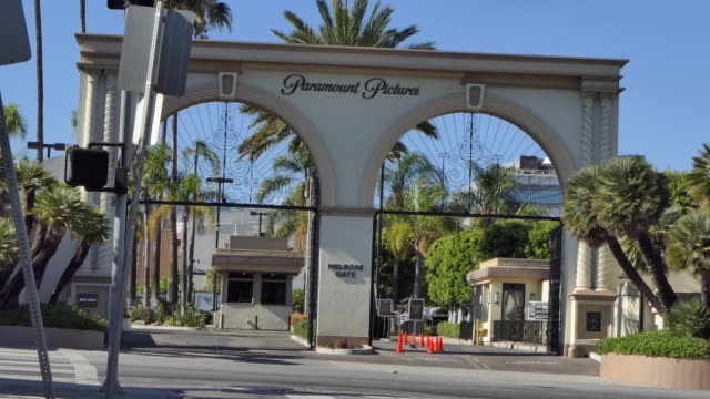 pov from the street at the paramount pictures front gate hollywood california film studio motion picture production - paramount pictures stock videos & royalty-free footage