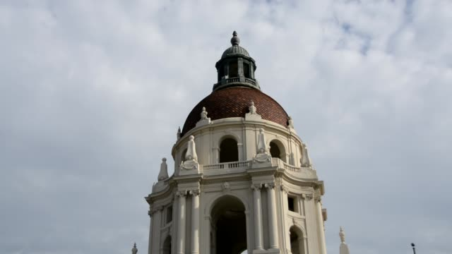 From the top of the Pasadena City Hall tilt down to street with cars driving by