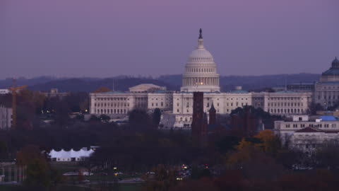 from the washington monument, flying past the smithsonian castle to the united states holocaust museum with capitol building in rear. shot in 2011. - smithsonian institution stock videos & royalty-free footage