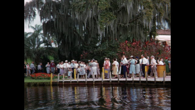 1954 home movie pov from tour boat / tourists in cypress gardens / winter haven, florida - 1954 stock videos & royalty-free footage
