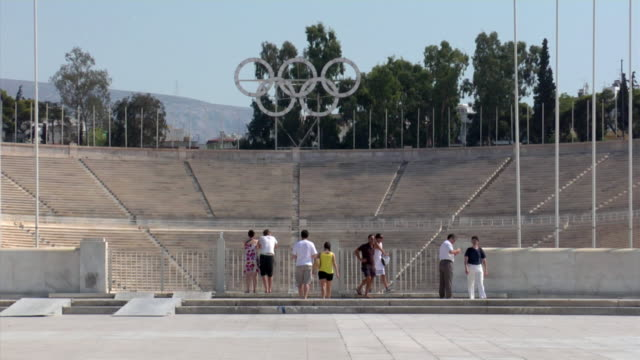 2008 ZO from tourists visiting the Panathinaiko Stadium with Olympic Rings to large plaza / Athens, Greece