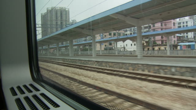 POV from train window of city landscape of Dongguan China
