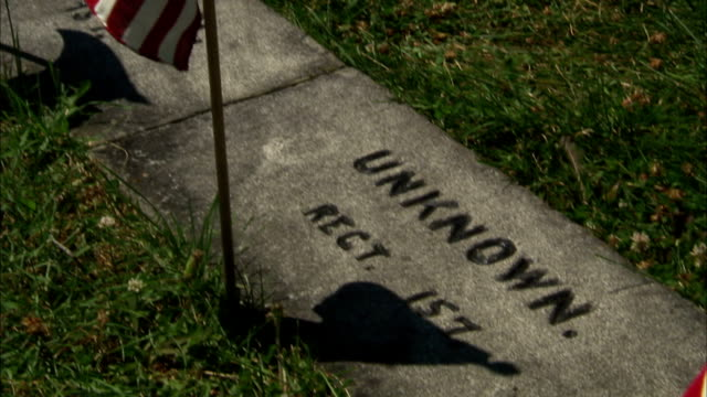 from unknown, rect 157 floor gravestone to american flags planted on field at gettysburg national cemetery on cemetery hill. pa, american civil war,... - gettysburg stock-videos und b-roll-filmmaterial