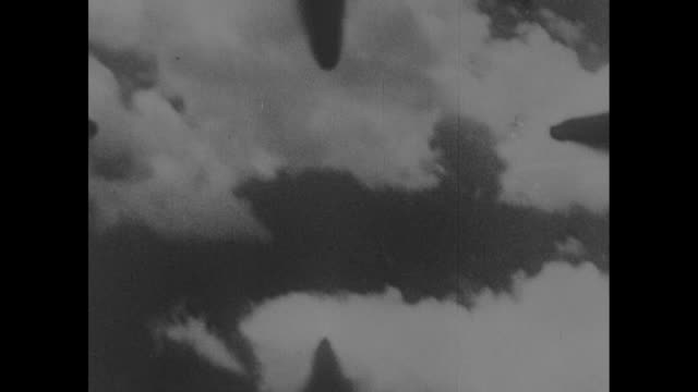 POV from US plane of a Japanese fighter airplane being pursued though the sky and shot down high above New Guinea / Note exact day not known
