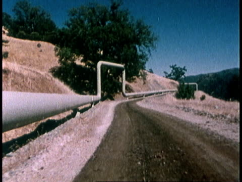 1978 pov from vehicle driving down road / united states - 1978 stock videos & royalty-free footage