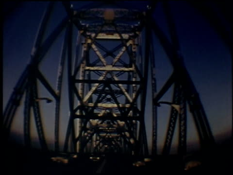 1957 montage from vehicle riding quickly through a tunnel and over a bridge at dusk, views of lights in the distance as it is getting dark / san francisco, california, united states - 1957 stock videos & royalty-free footage