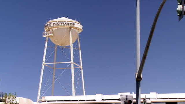 ws zo from water tower to studio gate at sony pictures movie studo at culver boulevard / culver city, california, usa - film studio stock videos & royalty-free footage