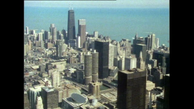 has from willis tower looking over chicago; 1985 - sears tower stock-videos und b-roll-filmmaterial