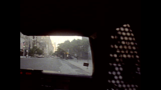 / POV from window of taxi driving south on 5th Avenue past the Metropolitan Museum of Art / midtown street scenes view of the Chrysler Building