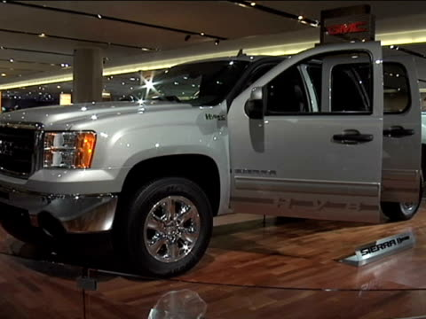 ws front and driver side of gmc sierra hybrid revolving on turntable / ws rear end of truckfootage is 43 anamorphic it will play back at 853x480 2009... - anamorphic stock videos and b-roll footage