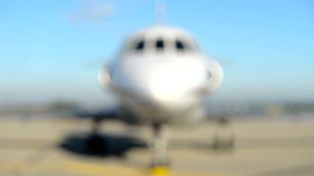 front close-up of a private jet airplane - front view stock videos & royalty-free footage