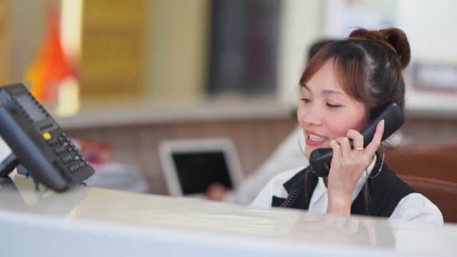 front desk or receptionist receiving a client in lobby - cross section stock videos & royalty-free footage