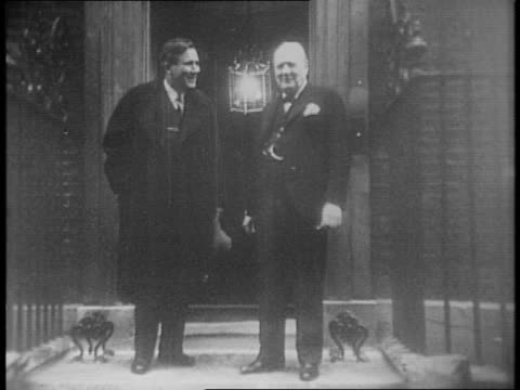 Front door of number 10 Downing Street / Wendell Willkie exits with Winston Churchill / Churchill sees him to his car / Churchill waves