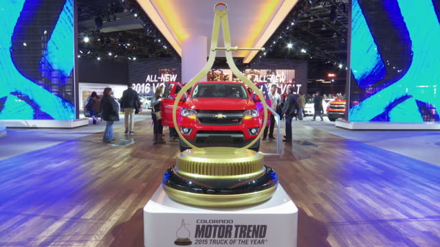 front end framed through the calipers of a giant motor trend truck of the year floor display / tilt down - passenger side profile / tilt up -... - calliper stock videos & royalty-free footage