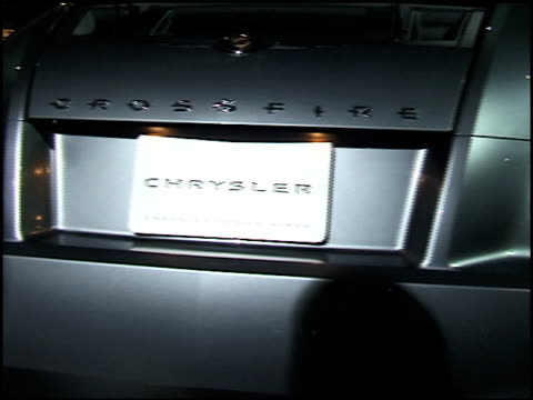 ms front end interior and rear end of chrysler crossfire revolving on turntable as narrator speaks in voiceover / ms floor sign passing through frame... - curious cumulus productions stock videos and b-roll footage