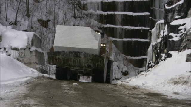 a front end loader moves blocks of granite from a mountain in vermont. - granite rock stock videos & royalty-free footage