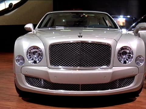 ws front end of bentley mulsanne sedan ws driver side profile doors are open to reveal white leather interior 2011 bentley mulsanne montage at cobo... - sedan stock videos & royalty-free footage