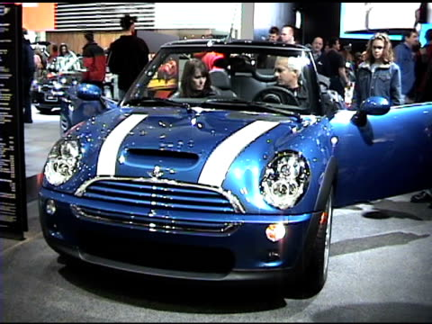 ws front end of blue mini cooper s convertible / ms front half of blue mini convertible / ms front end hood and grill of blue mini convertible / ws... - blue convertible stock videos & royalty-free footage