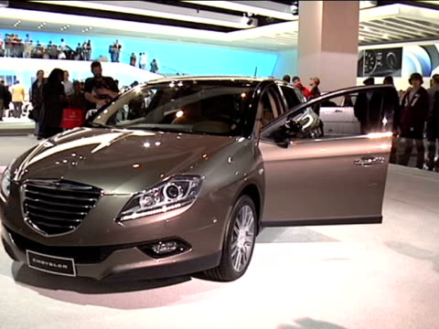 ws front end of chrysler concept car revolving on turntable / ws rear end of car on turntable gorgeous woman explains that car is just a design study... - anamorphic stock videos and b-roll footage