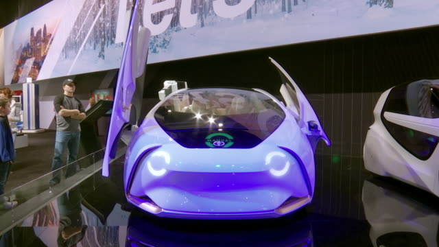 stockvideo's en b-roll-footage met shot front end of concepti both scissor doors open up simultaneously / ws front end headlights blink / closeup toyota logo and led display on hood... - toyota motor