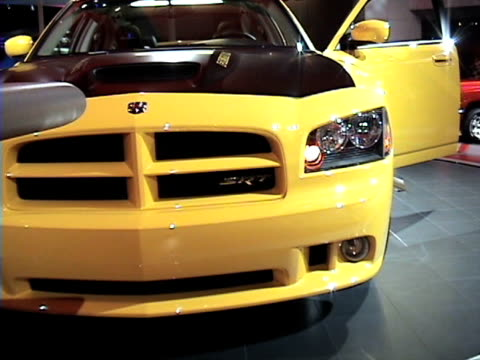 ms front end of dodge charger super bee revolving on turntable / ws rear end of car / ms front half of passenger side profile / cu super bee fender... - curious cumulus productions stock videos and b-roll footage