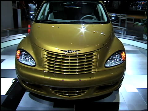 front end of dream cruiser series 1 revolving on turntable / passenger side profile of pt cruiser / dashboard through closed window / taillight,... - audio hardware stock videos & royalty-free footage