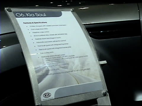 ws front end of kia soul concept crossover utility vehicle revolving on turntable / cu headlight / cu information sign / ws passenger side with doors... - driver's license stock videos and b-roll footage