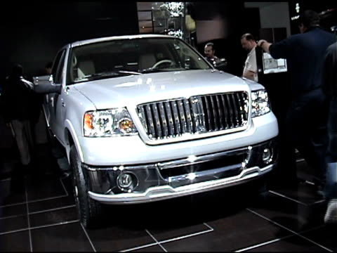ws front end of lincoln mark lt luxury pickup truck / cu lincoln logo embossed on arm rest zo to ms of white leather interior / cu lincoln logo on... - image manipulation stock videos and b-roll footage