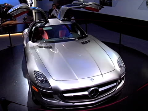 ws ha front end of mercedesbenz sls amg with gullwing doors up / ws driver side profile / cu driver side pov of interior zi to xcu controls on center... - anamorphic stock videos & royalty-free footage