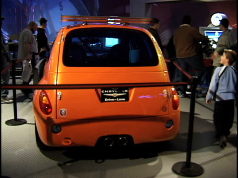 ws ha front end of octane orange pt super cruiser / ws info sign at base of car tilt up to driver side view down length of car / ws rear end / ms ha... - three quarter length stock videos & royalty-free footage