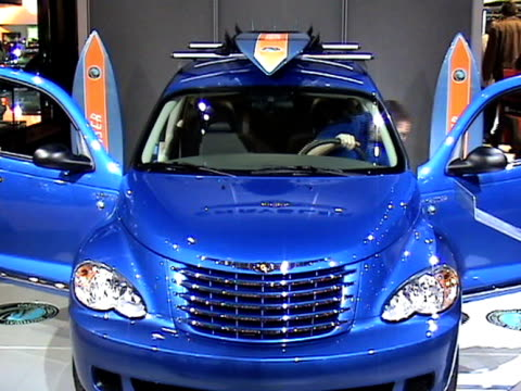ws front end of pt cruiser pacific coast edition cu pacific coast logo embedded in floor tilt up to ms front driver side pan to rear of car pan to... - curious cumulus productions stock videos and b-roll footage